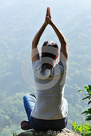 Yoga woman mountain top