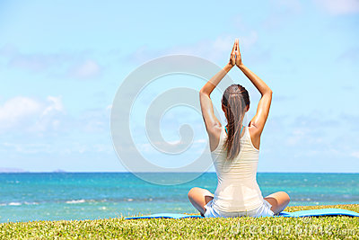 Yoga woman relaxing by sea