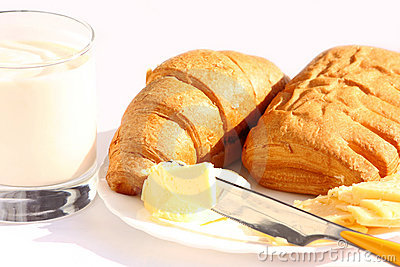Yoghurt, butter, cheese, croissant and roll
