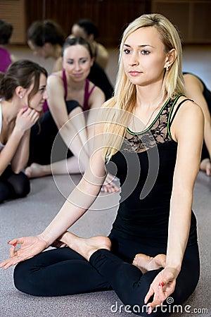 Free Yogi Girl Exercising, Doing Yoga Pose Sukhasana Royalty Free Stock Images - 49921169