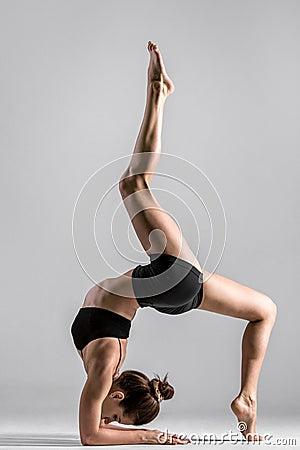 Free Yogi Gymnast Girl Performs Acrobatic Exercise Stock Photography - 49030542