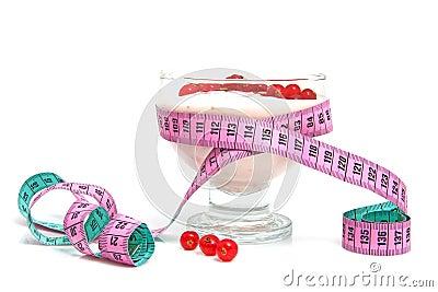 Yogurt,berrie fruit and measure tape