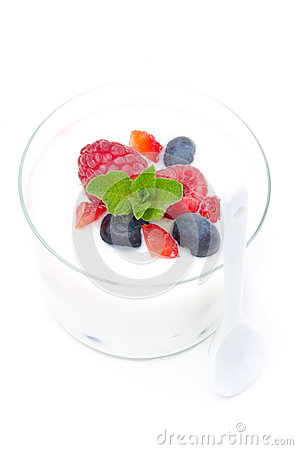Yogurt with different fresh berries and mint in a glass beaker