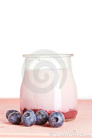 Yogurt and fresh blueberries