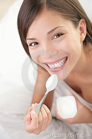 Yogurt woman eating