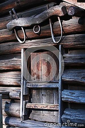 Yoke above window on frontier log building,