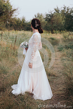Free Yong Bride Spinning In A White Dress On The Bank On Nature. Royalty Free Stock Images - 85860449