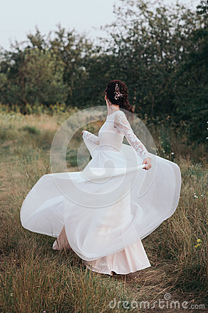 Free Yong Bride Spinning In A White Dress On The Bank On Nature. Royalty Free Stock Images - 85860919