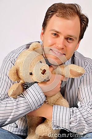 Yong man hugging teddybear