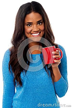 You woman enjoying her morning coffee