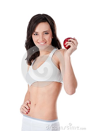 Yound fit girl holding red apple