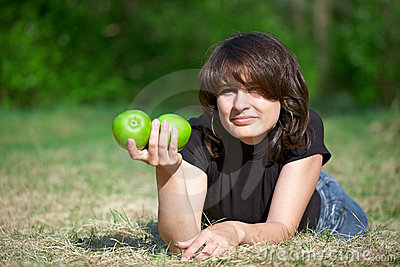 Young adult girl holding two apples in hand