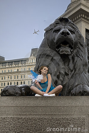 Young adult girl sitting at Trafalgar Square.