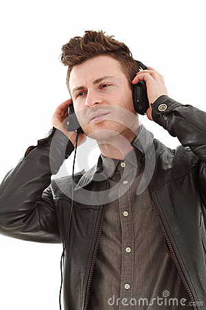Young Adult Male Listening Music Stock Images - Image: 25689474