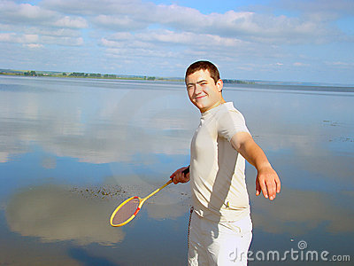 Young adult man with a racket .