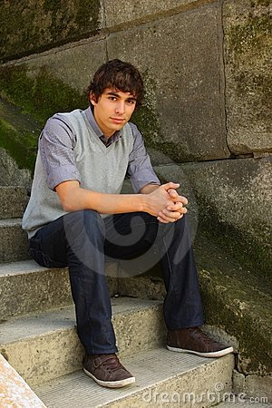 Young adult man sitting