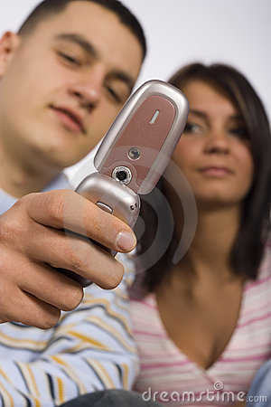Young Adult Man And Woman With Cell Phone