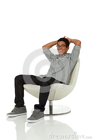 Free Young Adult Relaxing On A Modern Chair Royalty Free Stock Photo - 28926155
