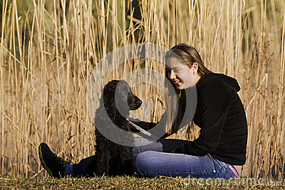 Young Adult Sitting With Her Dog