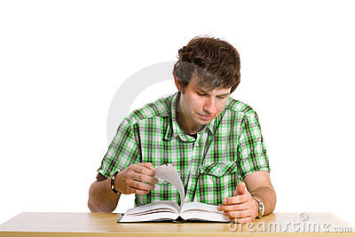 Young adult student look through the book