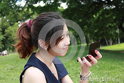 Young adult woman look mirror