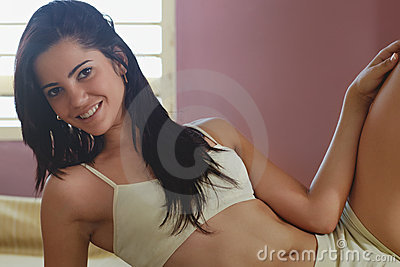 Young adult woman relaxing on bed