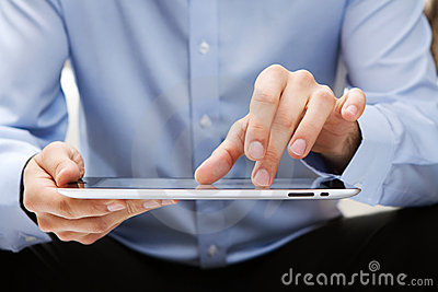 Young adult working on a digital tablet