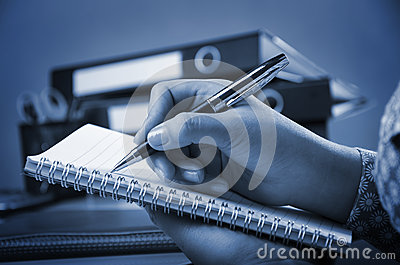 Writing on note book