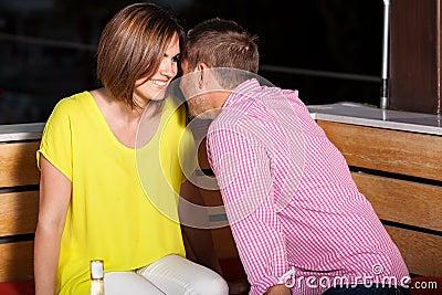 Young adults flirting at a bar
