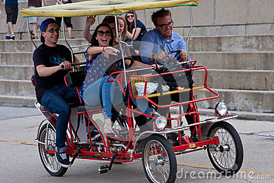 Young Adults Pedal A Four-Wheeled Cycle In Chicago Editorial Photo