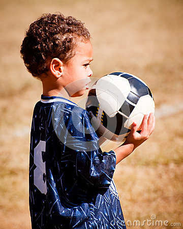 Young African-American boy with soccer ball