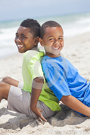 Young African American Boys Sitting on Beach