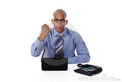 Young African American businessman, clenched fist