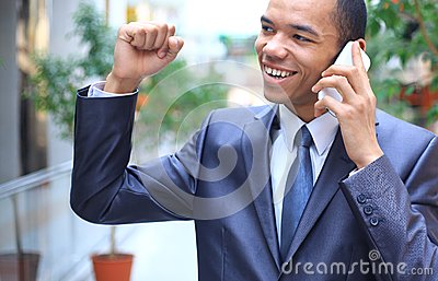 Young african american businessman on mobile phone