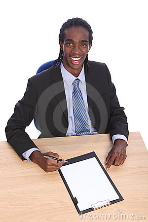 Young African American businessman at office desk