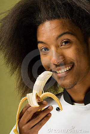 Young African American Chef Holding Banana
