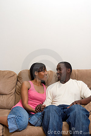 Young African american couple in their Living Room