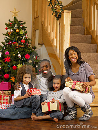 Young African American family with gifts