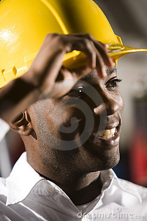 Young African American male worker in a hardhat