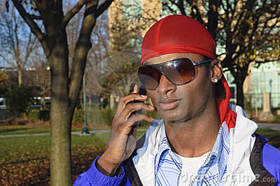 Young African American man on a cell phone