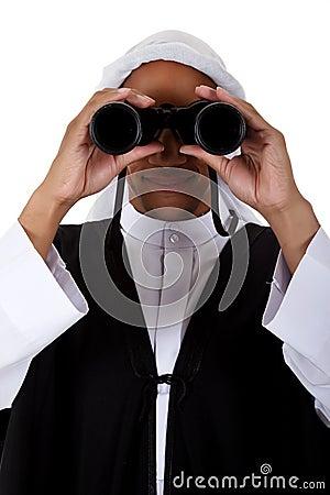 Young African American man, sheikh, binoculars