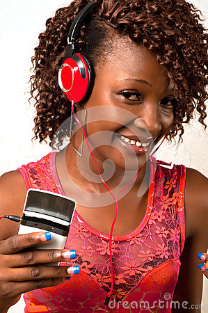 Young African American woman listening to music wi