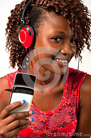 Young African American woman listening to music with headphones
