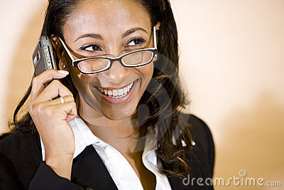 Young African-American woman talking on phone