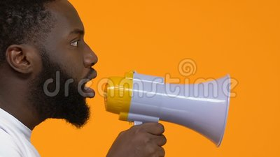 Young african male shouting in megaphone, protest action, speech freedom, leader. Stock footage stock footage
