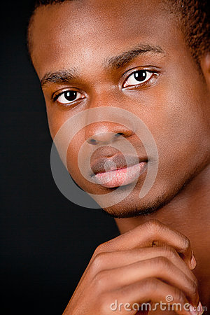 Young african man with dark skin looking