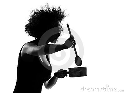 Young afro american woman silhouette cooking