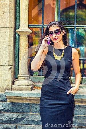 Free Young American Businesswoman Talking On Cell Phone Outside Stock Photos - 93740363