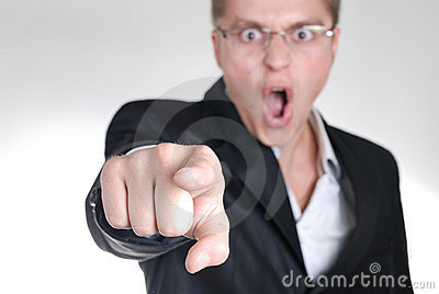 Young angry businessman pointing out his finger to
