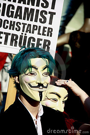 Young Anonymous activist with Guy Fawkes mask Editorial Stock Photo